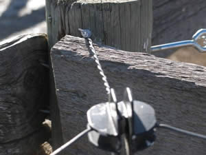 Nails or staples - the WRONG way to secure corner insulators in electric horse fencing.