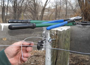 Long screw-eyes - the strongest way to secure corner insulators in electric horse fencing.