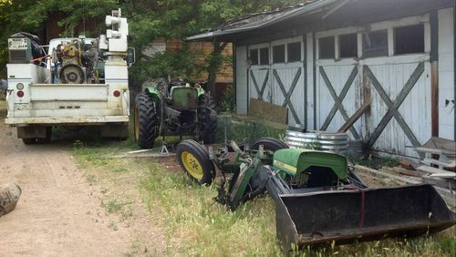 John Deere 950 in pieces following a thrown engine rod.
