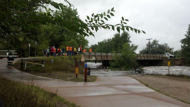 Engineers survey bridge flood scene