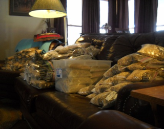 We turn television time into productive time by filling up a month's worth of zippered feed bags in our living room. (Click on photo to enlarge.)